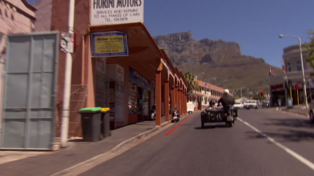 Tracking shot of two motorbikes with sidecars riding towards camera Available in HD