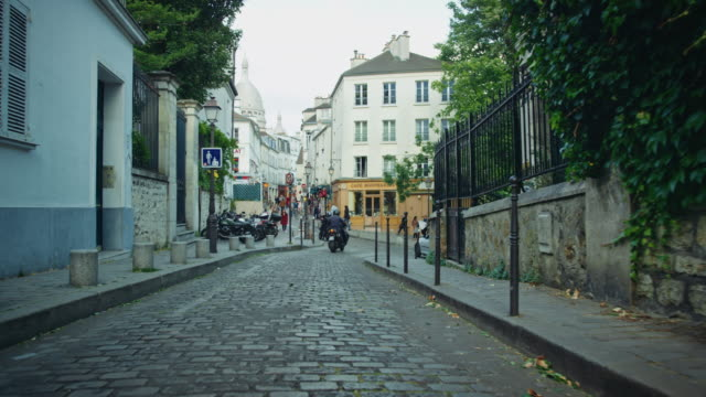 tracking shot of typical montmartre streets, sacré-coeur basilica in the background - motor scooter stock videos & royalty-free footage
