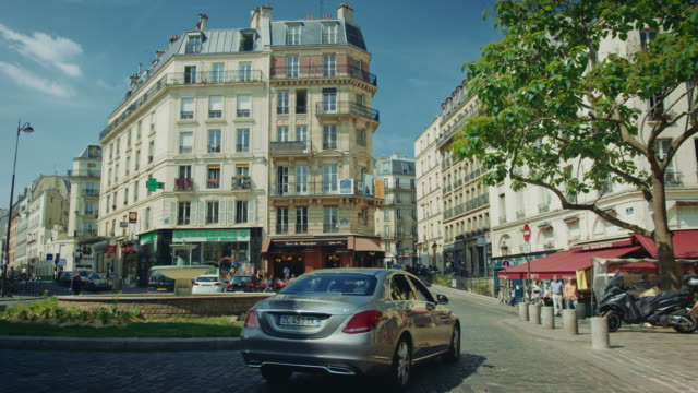 Tracking shot of typical Paris streets, car passing by