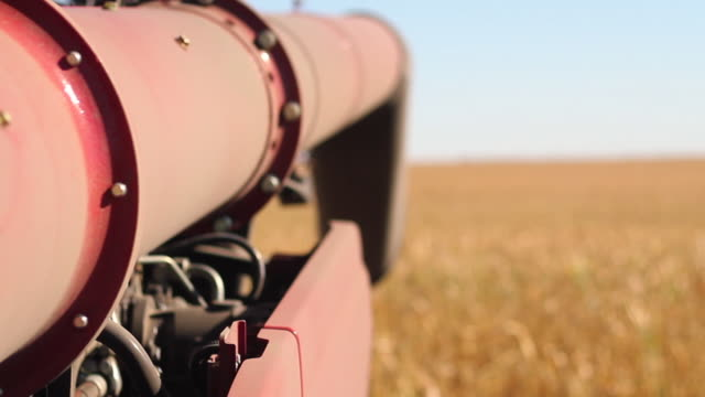 tracking shot of unloading auger - trattore video stock e b–roll