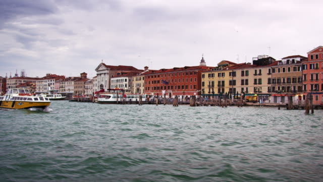 tracking shot of venice from a waterbus, approaching st. mark's basilica. - boat point of view stock videos & royalty-free footage