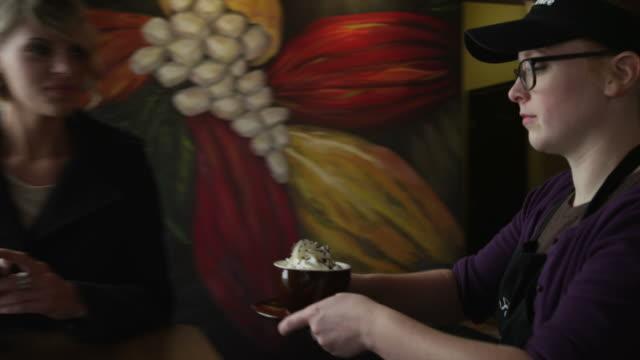 vídeos de stock, filmes e b-roll de tracking shot of waitress serving coffee to customer / orem, utah, united states,  - orem