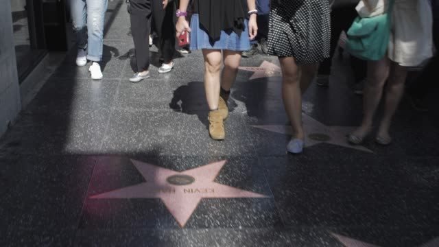 Tracking shot of Walk of Fame on Hollywood Boulevard, Hollywood, Los Angeles, LA, California, United States of America, North America