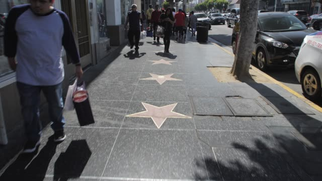 tracking shot of walk of fame on hollywood boulevard, hollywood, los angeles, la, california, united states of america, north america - walk of fame stock videos & royalty-free footage
