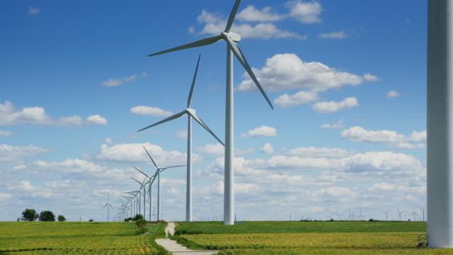 tracking shot of windfarm. summer. - turbine stock videos & royalty-free footage