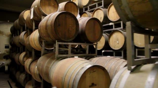 4k tracking shot of wine barrels aging in an australian winery - アデレード点の映像素材/bロール
