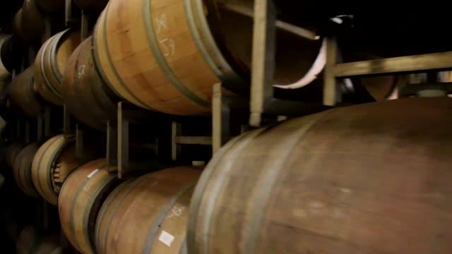 4k tracking shot of wine barrels aging in an australian winery - viniculture stock videos & royalty-free footage
