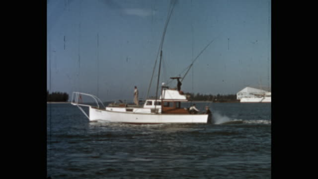 tracking shot of yacht moving in sea, florida, usa - amateurfilm stock-videos und b-roll-filmmaterial