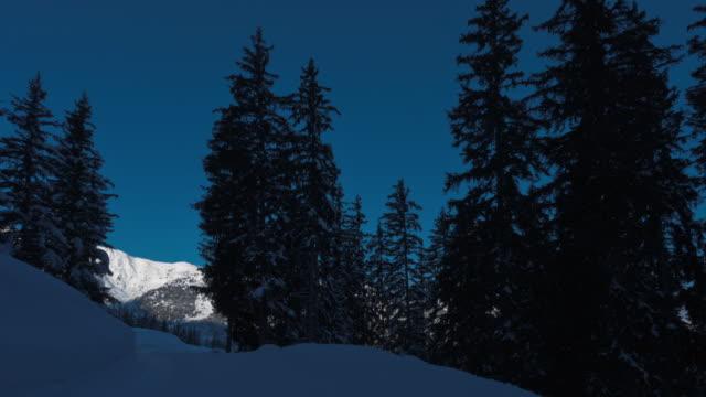 tracking shot on a cross-country ski run at sunrise - meribel stock videos & royalty-free footage