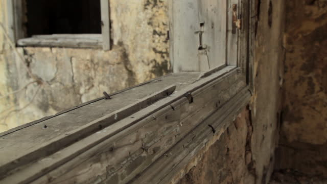 tracking shot over a wooden window frame in a derelict building. - window frame stock videos & royalty-free footage