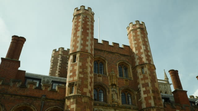 tracking shot over the exterior of st john's college, cambridge. - cambridge university stock videos and b-roll footage