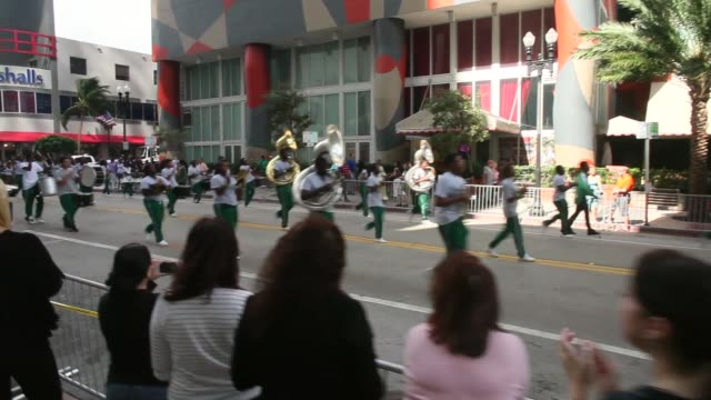 tracking shot parade marching to honor veterans of the vietnam war the bay of pigs and all wars the city of miami holds the miamidade county golden... - miami dade county bildbanksvideor och videomaterial från bakom kulisserna