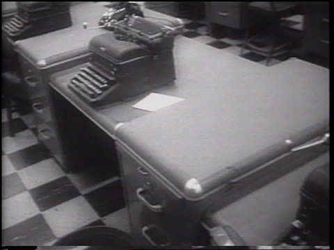 tracking shot past desks with typewriters on them in empty newspaper office during strike / nyc - newspaper strike stock videos & royalty-free footage