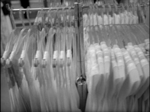 tracking shot past rails of night gowns in a department store. - nightdress stock videos & royalty-free footage