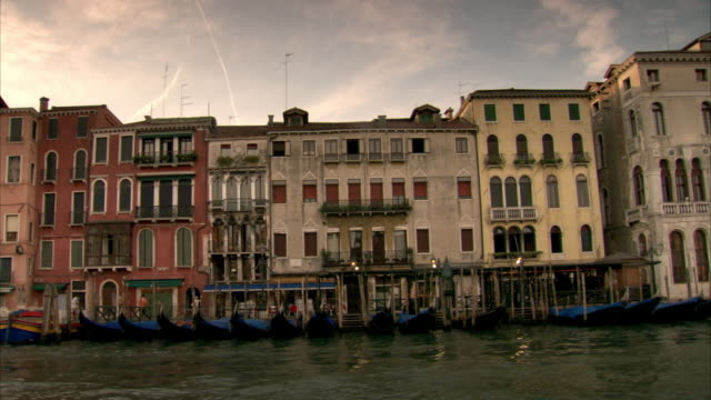 tracking shot past the waterfront buildings on the grand canal in venice. - canal stock videos & royalty-free footage