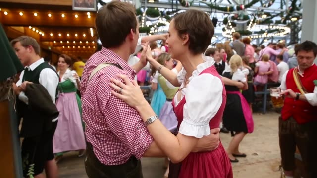 Tracking Shot revellers dance at the Schottenhamel beer tent during day 1 of the Oktoberfest 2013 beer festival at Theresienwiese on September 21...