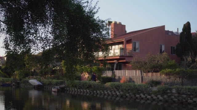 tracking shot, riverside houses in california - waterfront stock videos & royalty-free footage