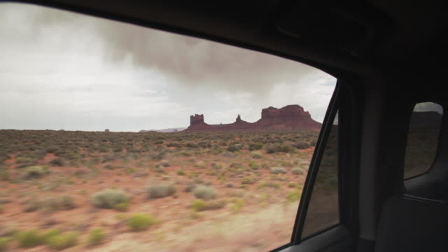 tracking shot, road trip through monument valley, utah - sandstone stock videos & royalty-free footage