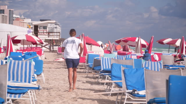 tracking shot, rows of colorful beach chairs - parasol stock videos & royalty-free footage
