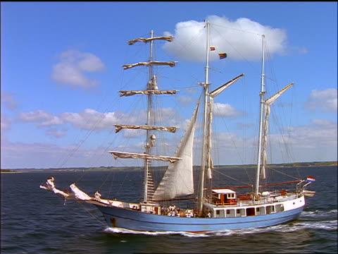 aerial tracking shot schooner on ocean / aero, denmark - sailing ship stock videos & royalty-free footage