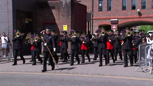 tracking shot showing a military brass band leaving windsor barracks during the rehearsal for the wedding of prince harry and meghan markle - brass band stock videos & royalty-free footage