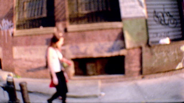overexposed out of focus tracking shot side view two women walking on city street - overexposed stock videos & royalty-free footage