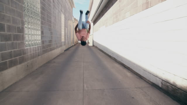 tracking shot, sm young man doing parkour in an alley way - tracking shot stock videos & royalty-free footage