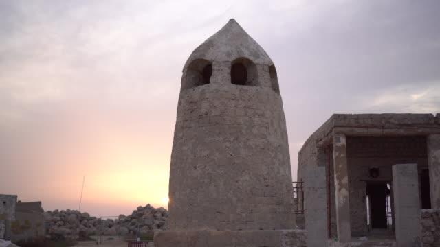 Tracking shot, sunset over abandoned buildings in Ras al-Khaimah
