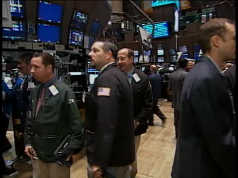 pov tracking shot that follows traders on the floor of the new york stock exchange - business or economy or employment and labor or financial market or finance or agriculture stock videos & royalty-free footage