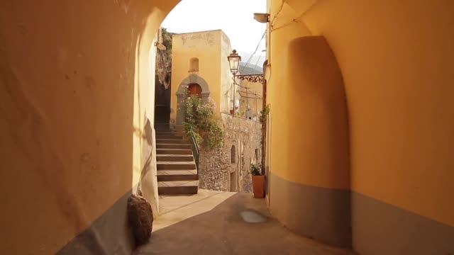 Tracking shot through a tunnel and the narrow streets of picturesque Positano, Amalfi Coast, Italy