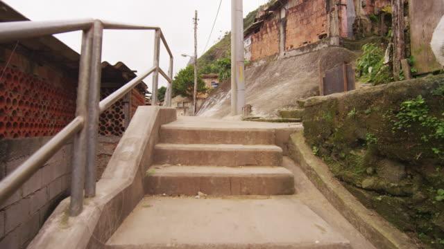 RIO DE JANEIRO, BRAZIL - JUNE 23: Tracking Shot through a well-traveled path of a favela
