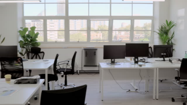 tracking shot through an empty office - absence stock videos & royalty-free footage