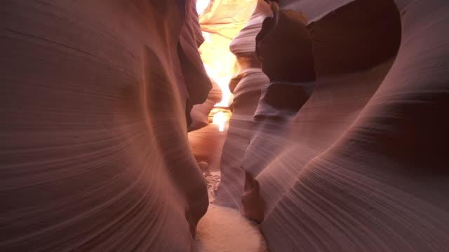 tracking shot through narrow slot canyon - slot canyon stock videos and b-roll footage