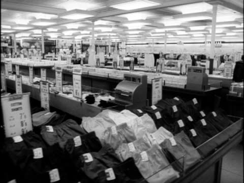 tracking shot through the menswear department of a department store. - sock stock videos & royalty-free footage