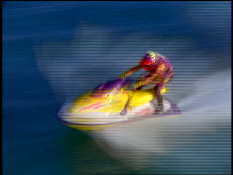 aerial tracking shot time lapse person in helmet riding jet boat speeding across water surface - acquascooter video stock e b–roll