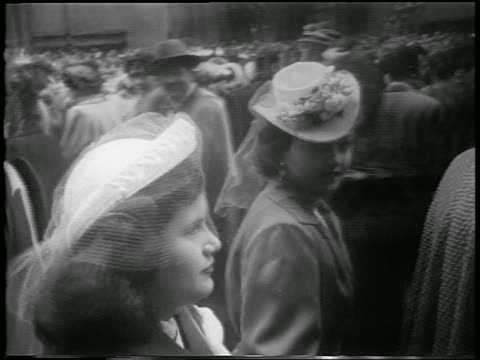 vídeos de stock e filmes b-roll de b/w 1952 tracking shot two women in fancy hats walking on street looking at camera / easter / nyc - 1950