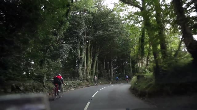 tracking shot view from car cyclists riding uphill stage six of the tour of britain made history this year as it was the first stage to host a summit... - tour of britain stock videos & royalty-free footage