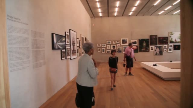 tracking shot visitors walk through a gallery during the opening day of the pérez art museum miami on december 4 2013 in miami florida the museum... - biscayne bay stock videos & royalty-free footage