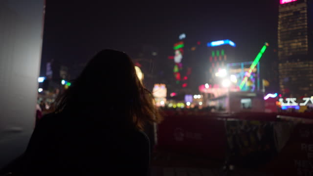 tracking shot, woman walks to carnival in hong kong, - tracking shot stock videos & royalty-free footage