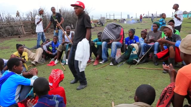 tracking shot, xhosa women sing and dance as young men take part in a manhood ceremony in qunu ahead of the funeral of nelson mandela on december 13,... - mascolinità video stock e b–roll