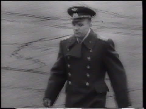 B/W 1961 tracking shot Yuri Gagarin in uniform walking outdoors / first man in space / USSR
