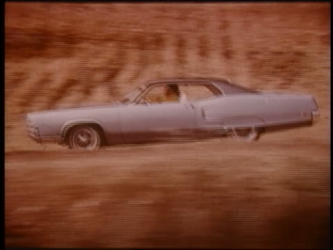 1970 tracking shot zoom out zoom in couple driving mercury marauder on hillside road - ford motor company stock videos and b-roll footage
