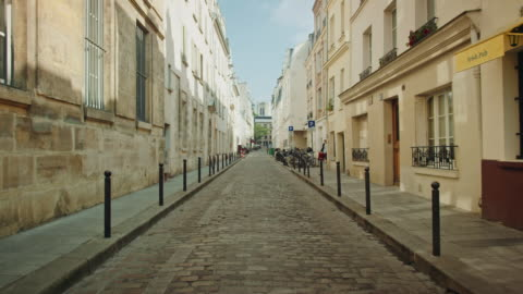 tracking shots of old streets near the mouffetard area - dolly shot stock videos & royalty-free footage