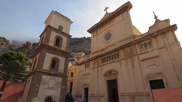 tracking the church of santa maria assunta, positano, amalfi coast, italy - amalfi stock videos and b-roll footage