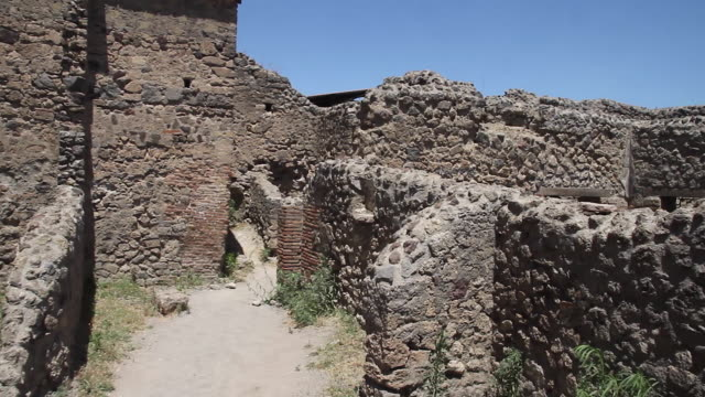 Tracking the ruined walls of ancient houses in Pompeii, Napoli
