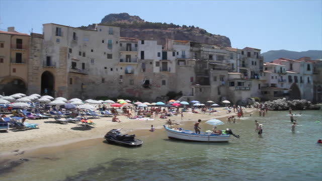 tracking the stunning, picturesque beach and town of cefalu, sicily - sicily stock videos & royalty-free footage