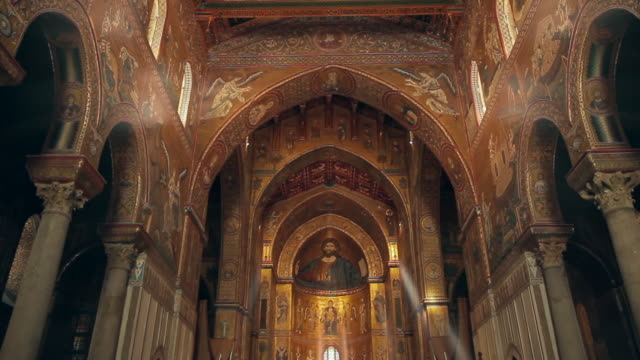 tracking through the stunningly ornate, gilded cathedral of monreale in palermo, sicily, italy - basilica stock videos & royalty-free footage