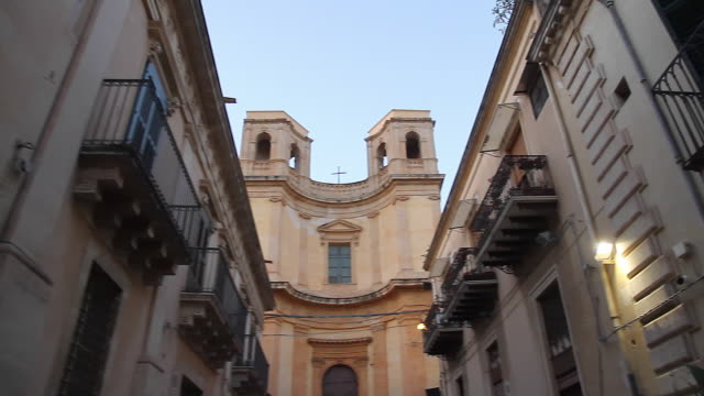 tracking typical baroque architecture in the beautiful town of noto, sicily, italy - sicily stock videos and b-roll footage