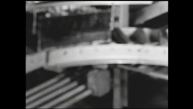 tracking view of various bins passing by on the conveyor belt inside factory - 1940 1949 stock videos & royalty-free footage