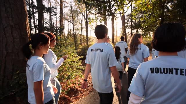 tracking volunteers walk in charity walk - volunteer stock videos & royalty-free footage